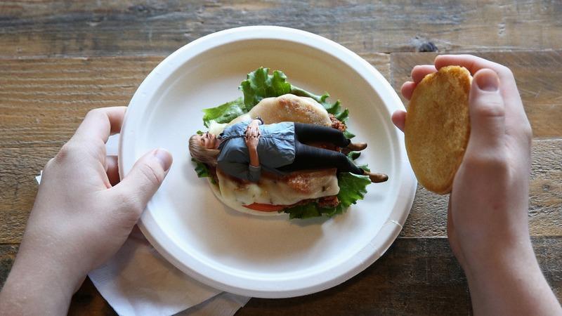 A Chik Fil A sandwich with an uncooked Nancy Grace inside.